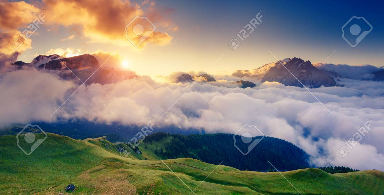 Great view of the foggy Val di Fassa valley with pass Sella. National Park. Dolomites (Dolomiti), South Tyrol. Location Canazei, Campitello, Mazzin. Italy, Europe. Dramatic scene. Beauty world. - 47565891
