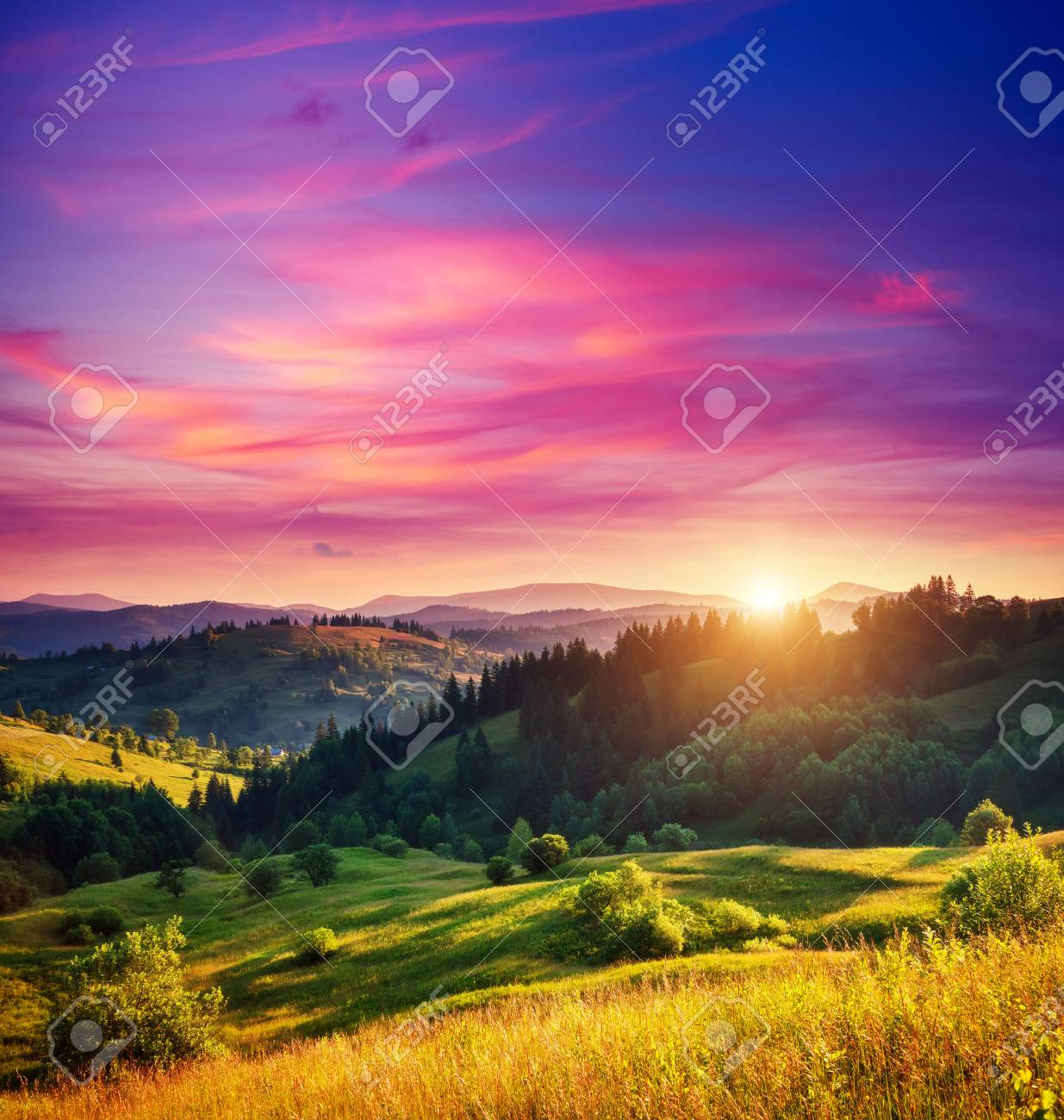 Beautiful green hills glowing by warm sunlight at twilight. Dramatic scene. Colorful sky, red clouds. Carpathian, Ukraine, Europe. Beauty world. - 47565709