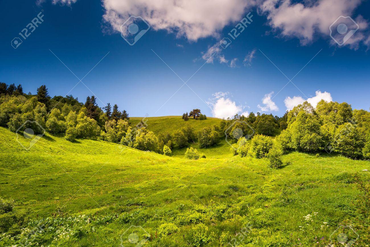 Beautiful view of rural alpine landscape. Sunny hills under cloudy sky. Upper Svaneti, Georgia, Europe. Caucasus mountains. Beauty world. - 47565604