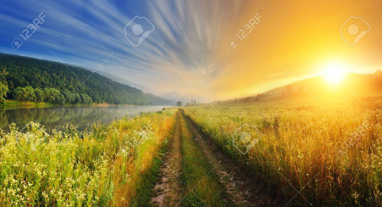 Fantastic foggy river with fresh green grass in the sunlight. Dramatic colorful scenery. Dnister river, Ternopil. Ukraine, Europe. Beauty world. Stock Photo - 47565607