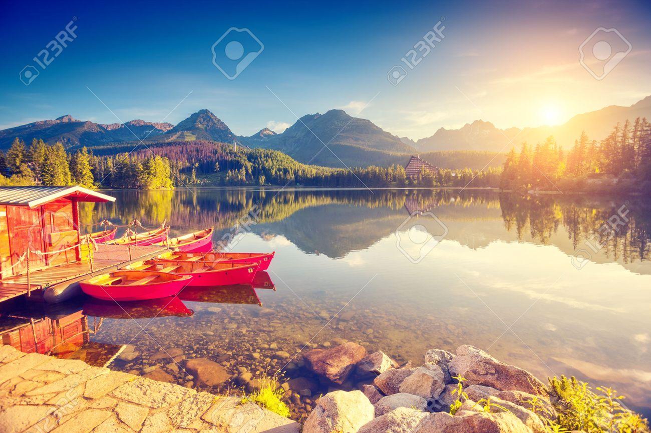 Fantastic mountain lake in National Park High Tatra. Strbske pleso, Slovakia, Europe. Dramatic unusual scene. Beauty world. Retro and vintage style, soft filter. toning effect. - 54994135