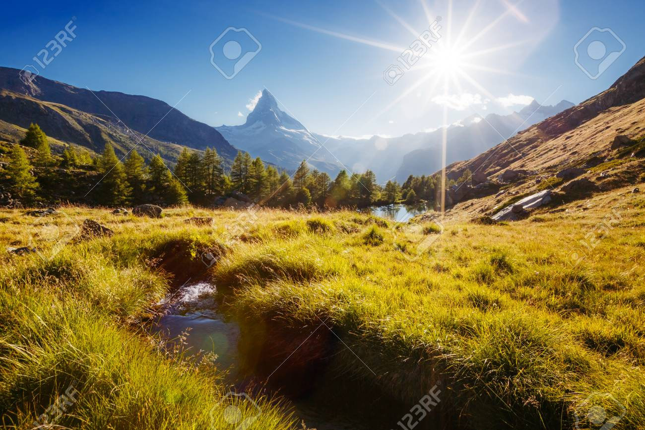 Great panorama with famous peak Matterhorn in alpine valley. Location place Swiss alps, Grindjisee, Valais region, Europe. - 85415978