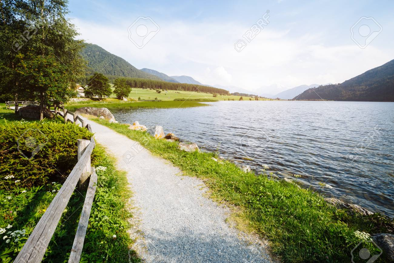Great mist view of the alpine valley with Haidersee lake. Picturesque and gorgeous morning scene. Location place San Valentino Alla Muta village, Bolzano, South Tyrol, Italy alp, Europe. - 95302072