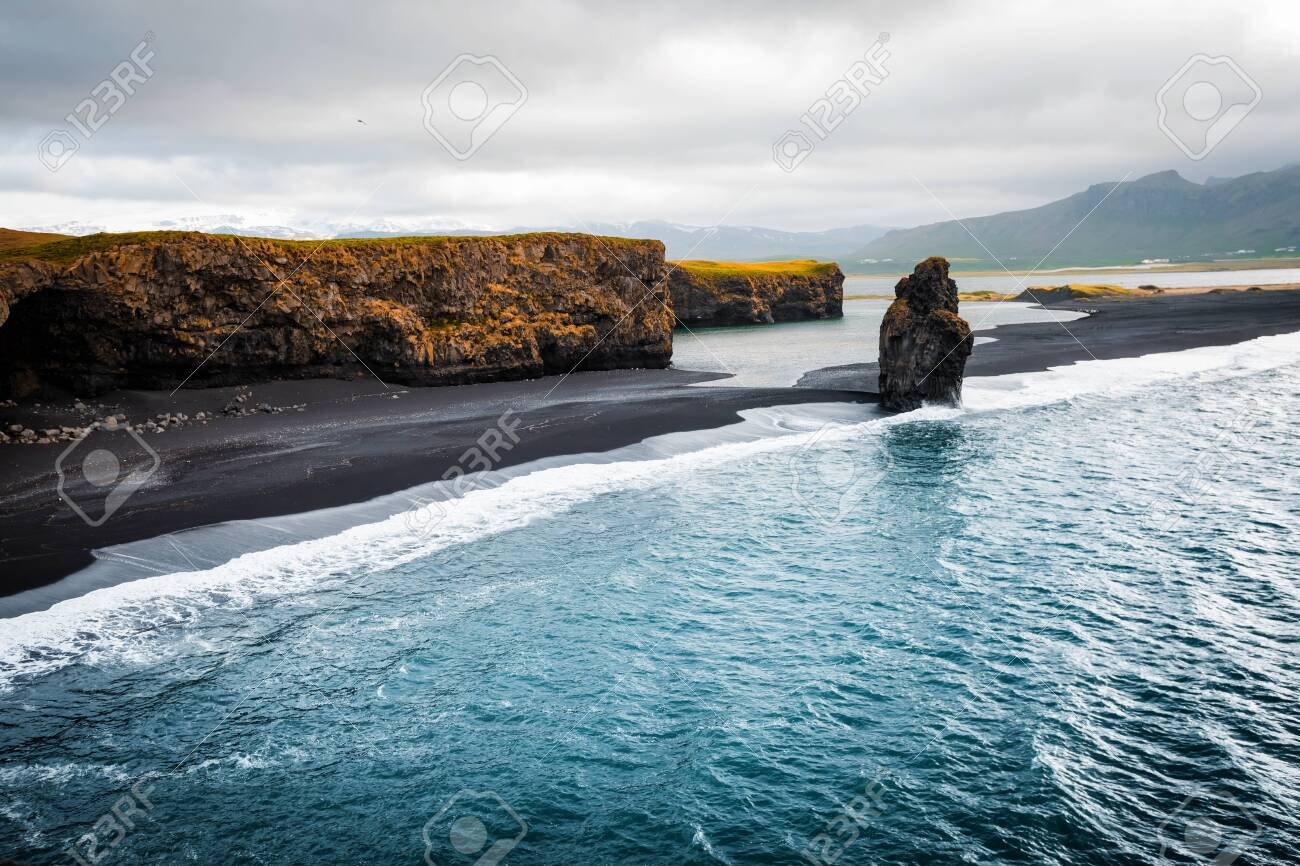 View on Kirkjufjara beach and Arnardrangur cliff. Location Myrdal valley, Atlantic ocean near Vik village, Iceland, Europe. Scenic image of amazing nature landscape. Discover the beauty of earth. - 123397087