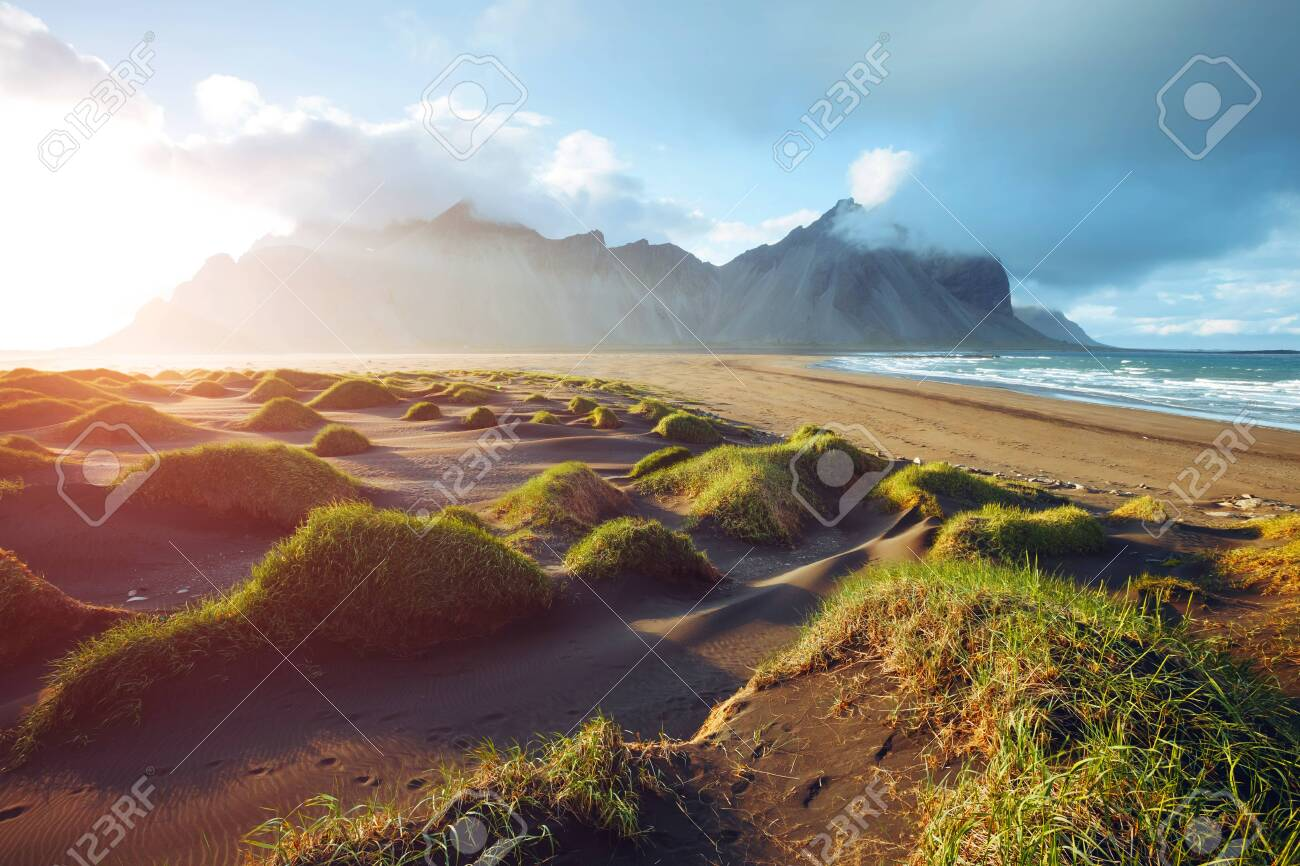 Majestic landscape on sunny day. Location Stokksnes cape, Vestrahorn Iceland, Europe. Scenic image of most popular tourist attraction. Travel destination. Discover the beauty of earth. - 140780459