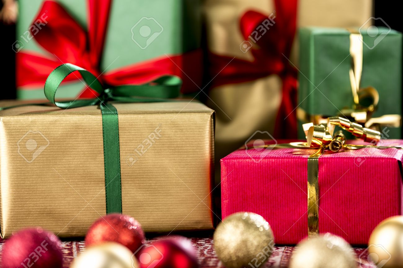 Gold and red ornaments - Presents With Bows Wrapped In Green Gold And Red Tightly Framed Close