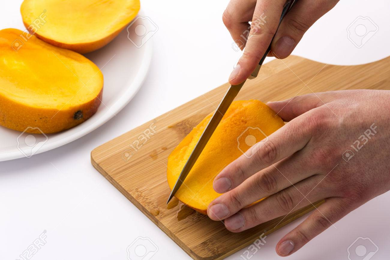 Stock Photo This Series Of Photos Shows How Best To Cut A Mango In A Second