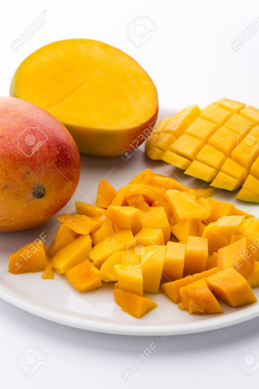 Heap Of Freshly Cut Mango Pulp Cubes On A Plate A Mango Third Scored To Heap
