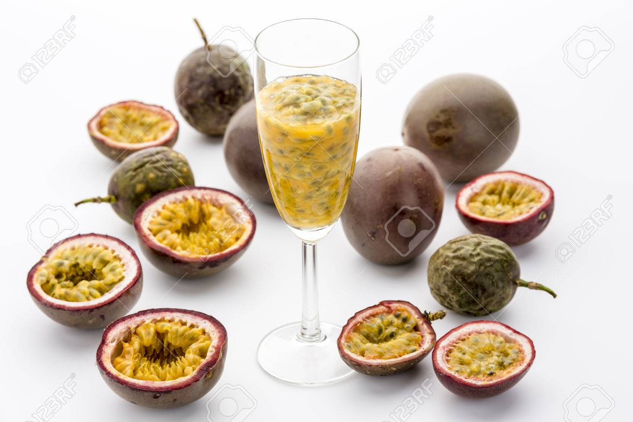 Yellow Passion Fruit Flesh, Juice And Seeds In A Champagne Flute ...