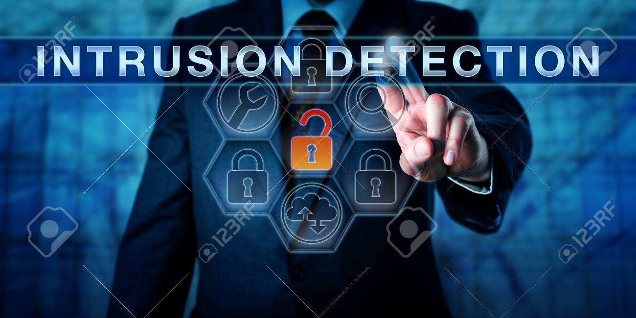 Businessman is pushing INTRUSION DETECTION on an interactive