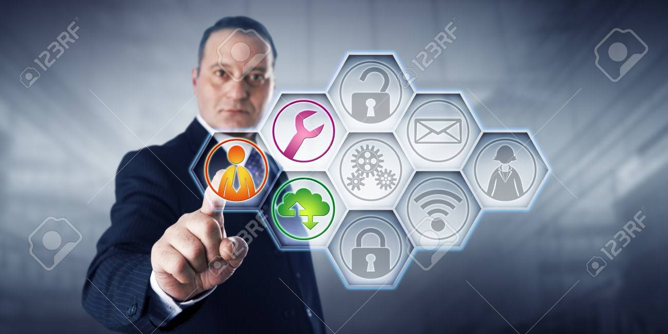 Confident business director is activating three managed services icons by touch on a control screen. The remaining six of nine IT buttons remain gray. Concept for efficiency through managed services. - 61131135