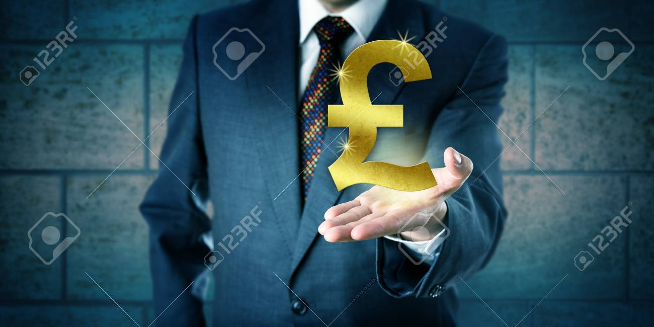 Forex Trader Holding A Golden British Pound Sterling Symbol In