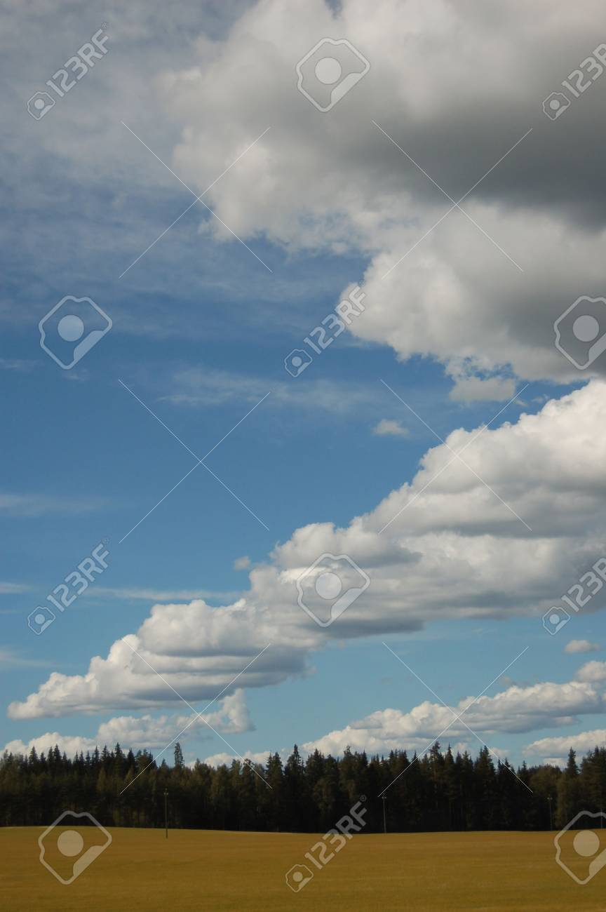 Storm clouds forming over a field Stock Photo - 552327