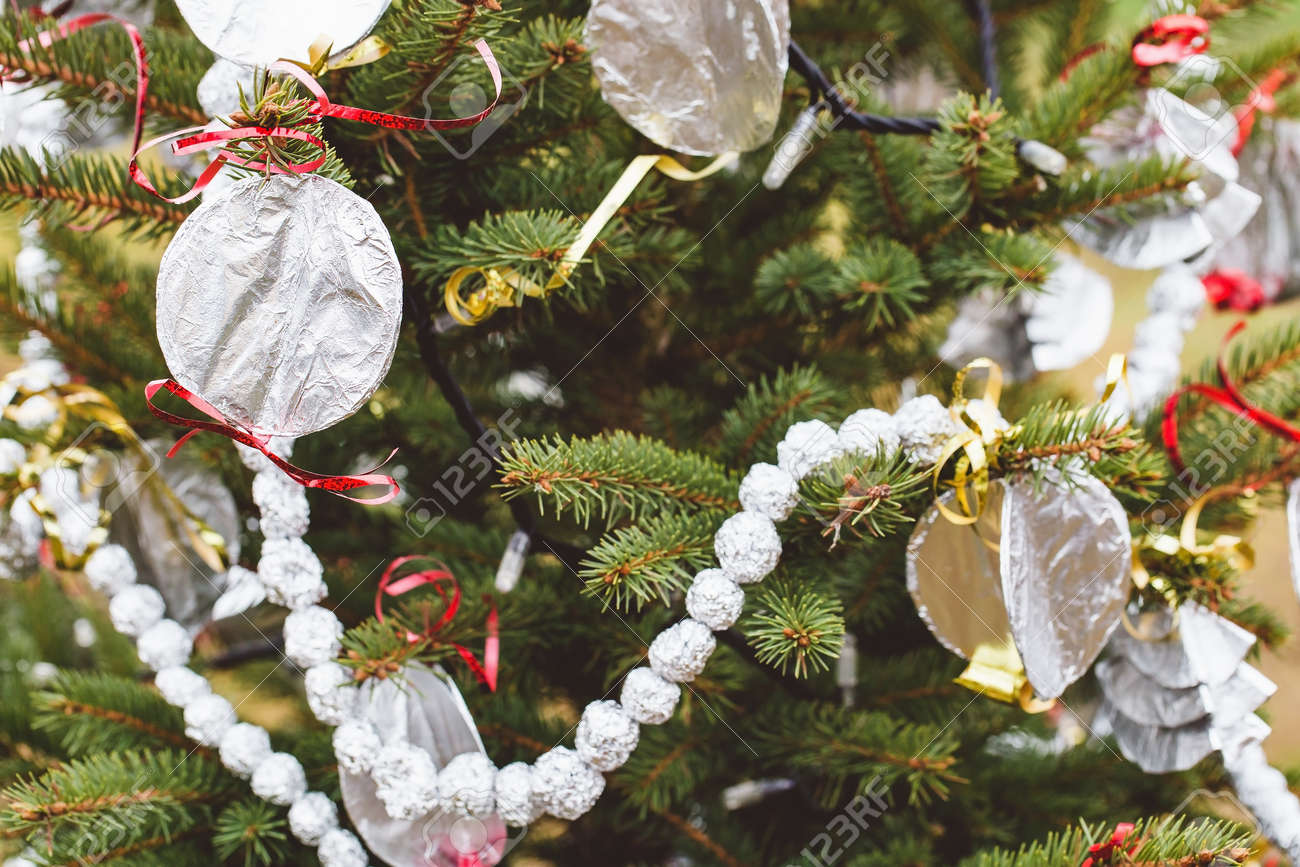 Aluminium Foil Handmade Decoration On A Christmas Tree Outdoor Stock Photo Picture And Royalty Free Image Image 159478851