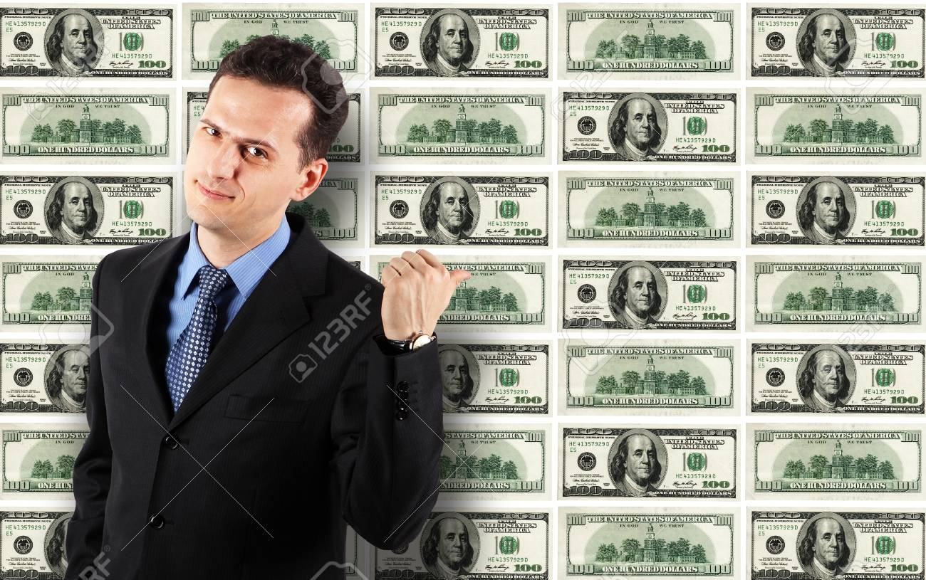 Standing Businessman on Dollars Background Stock Photo - 12391157