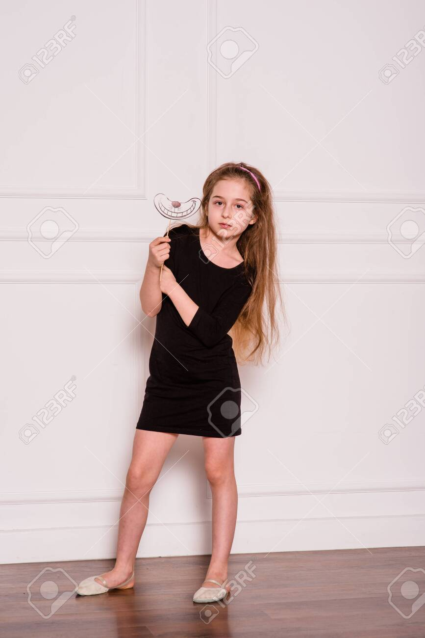 Little Fashion Model In Dress Photo In Photostudio Backstage Stock Photo Picture And Royalty Free Image Image 128193604