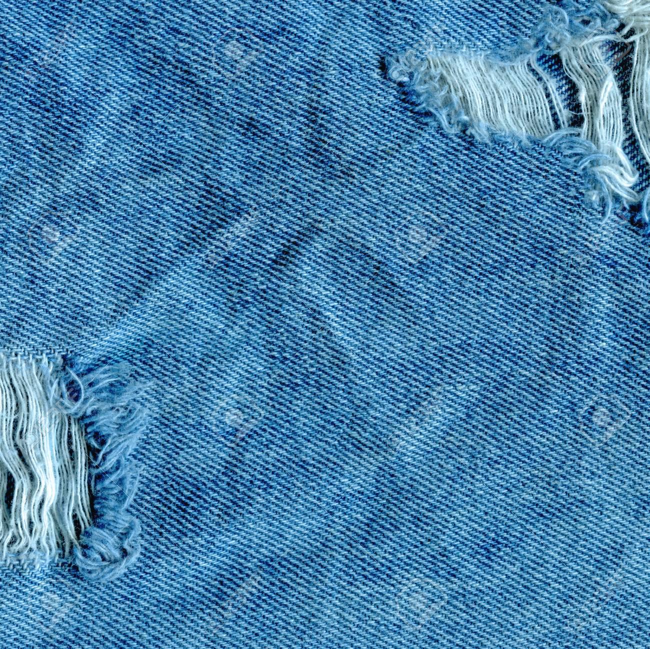 73899196f Textura vieja de la mezclilla de Japón del dril de algodón. Jeans  desgarrado textura de mezclilla. Jeans rasgados destruidos