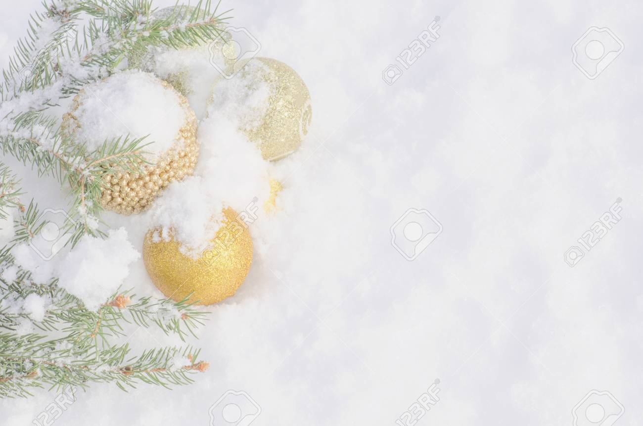 christmas border decoration and christmas tree branch on snow christmas tree branches with golden baubles