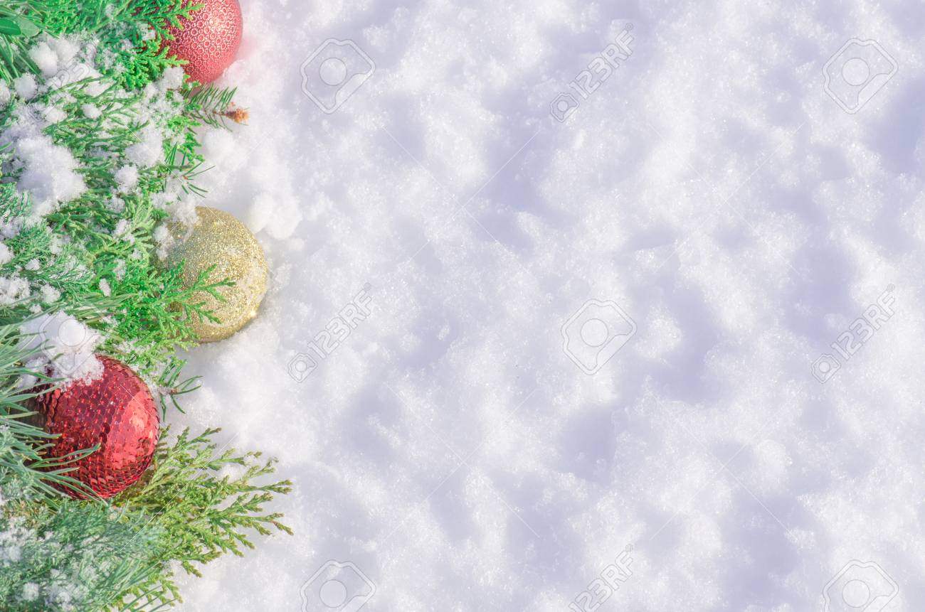 Christmas Background With Balls And Decorations On White Snow
