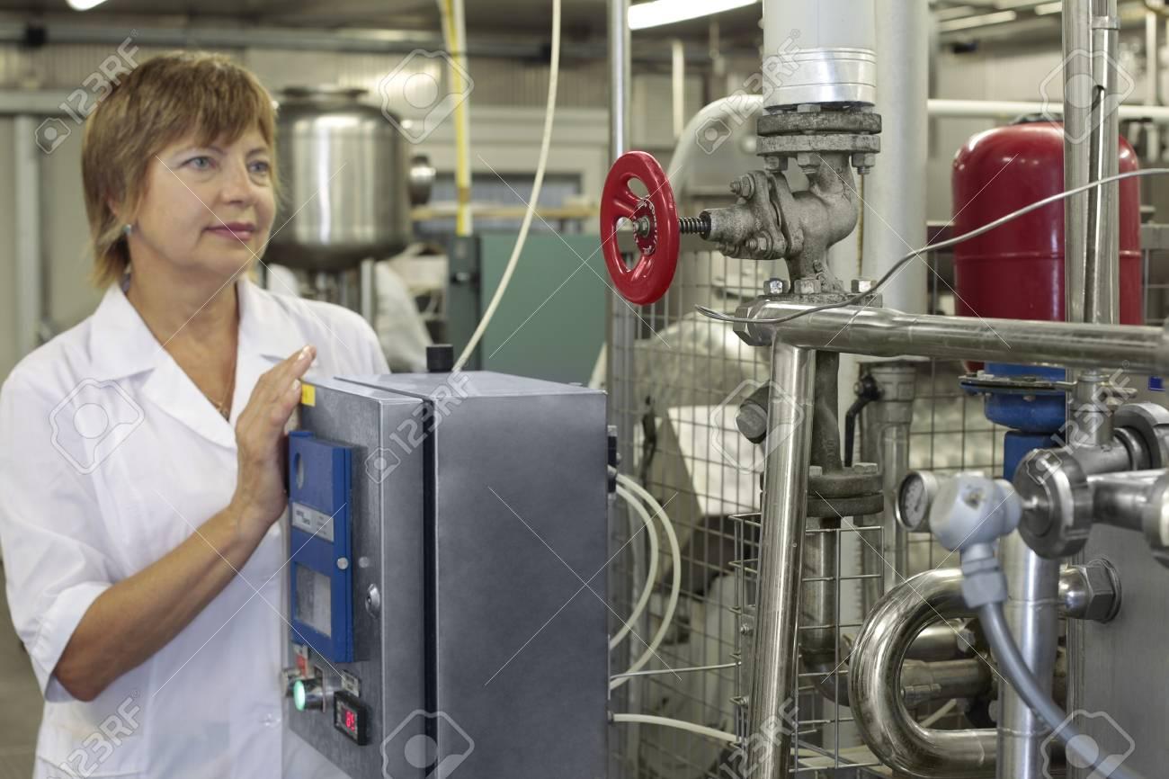 worker on a modern milk factory - 26030634