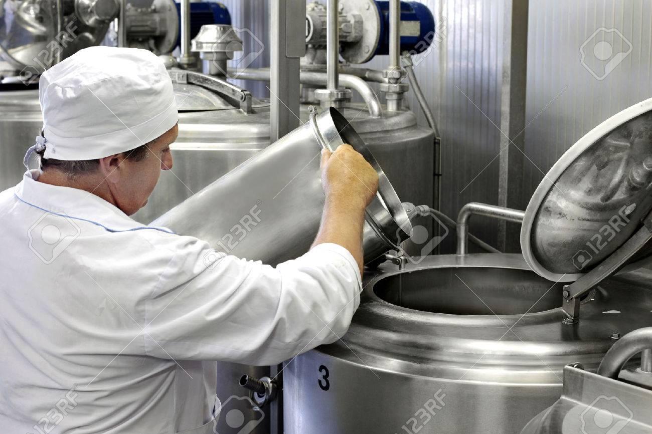 worker on a modern milk factory Stock Photo - 26030635