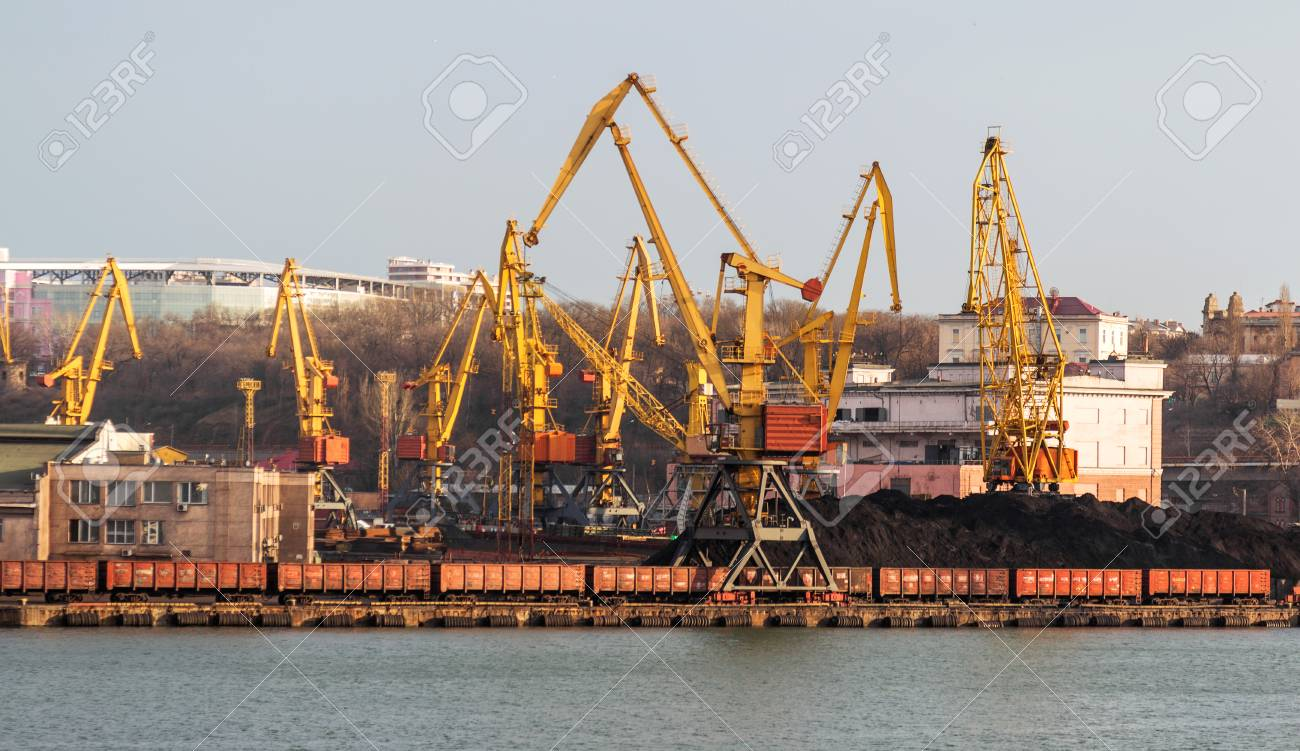 A large large cargo ship enters the harbor of a container terminal
