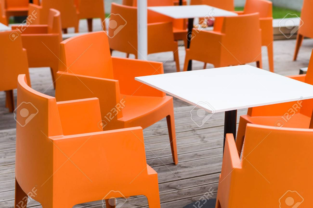 Modern furniture outdoor cafe terrace with orange chairs stock photo 40975016