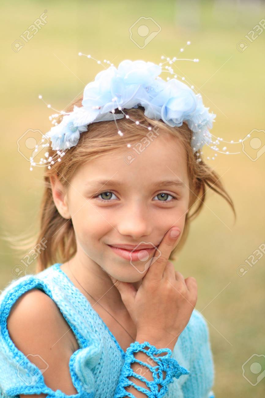 Portrait of the beautiful litle girl in blue Stock Photo - 9773244