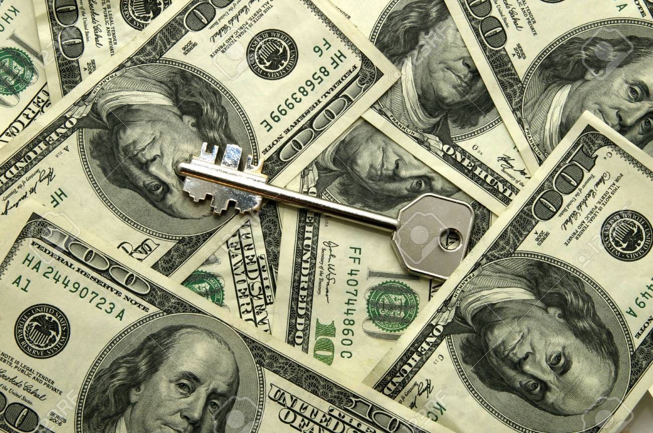 the key to the housing and a lot of dollars of American money Stock Photo - 12207008
