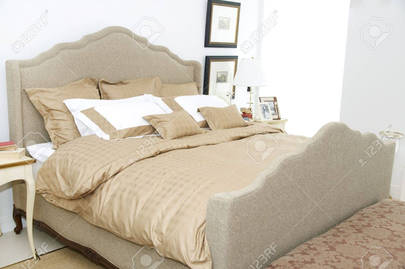Stock Photo A Large Comfortable Bedroom With A Bed And Lots Of Pillows