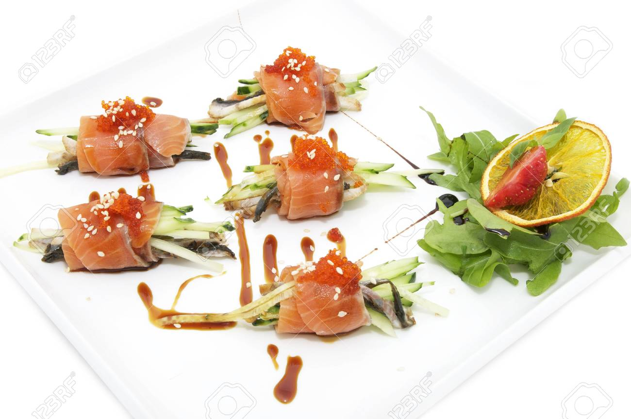 Fish rolls with herbs and fruit on a plate Stock Photo - 13728419