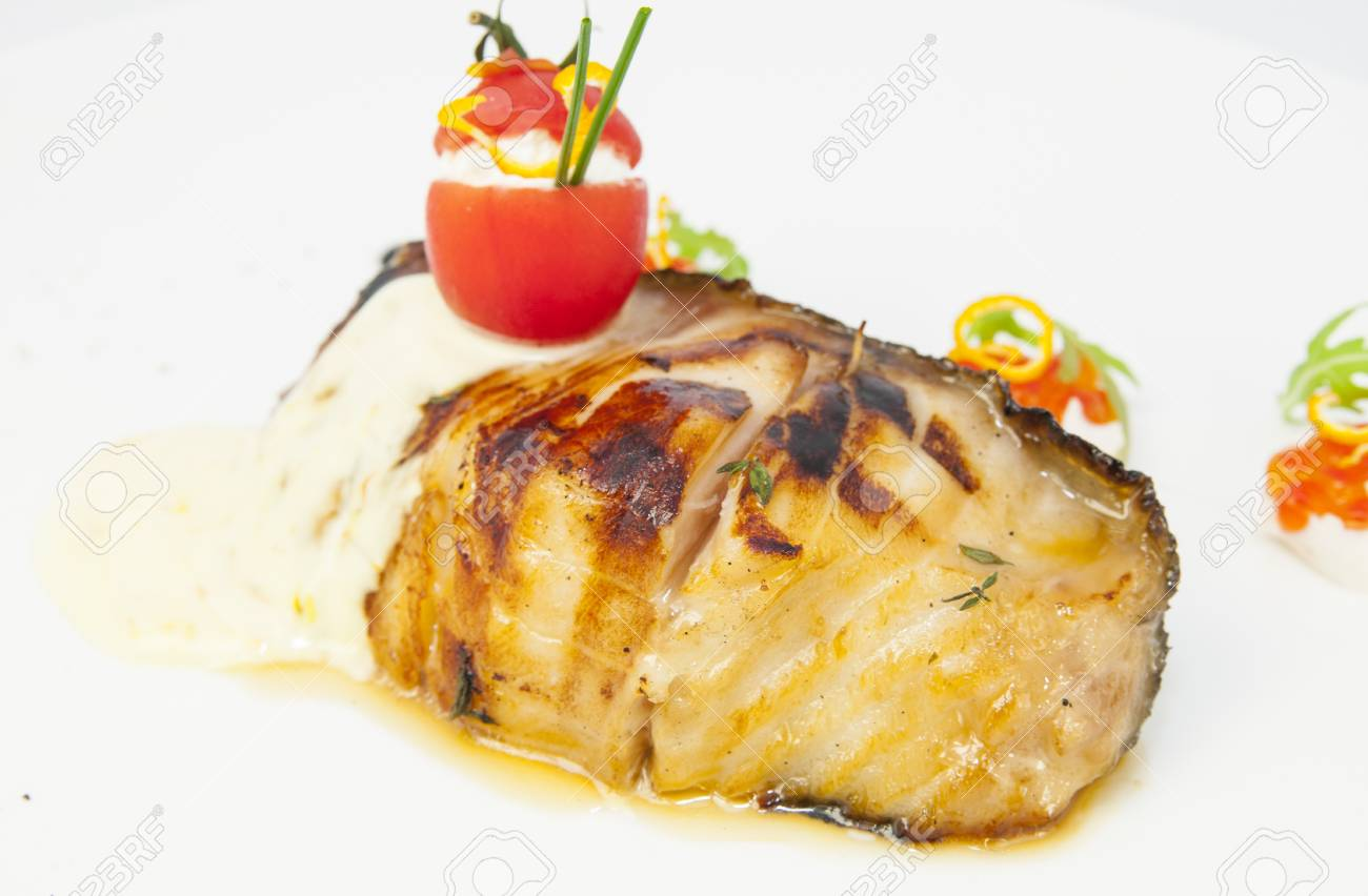 Roasted fillet of grilled fish in a white sauce Stock Photo - 15966719