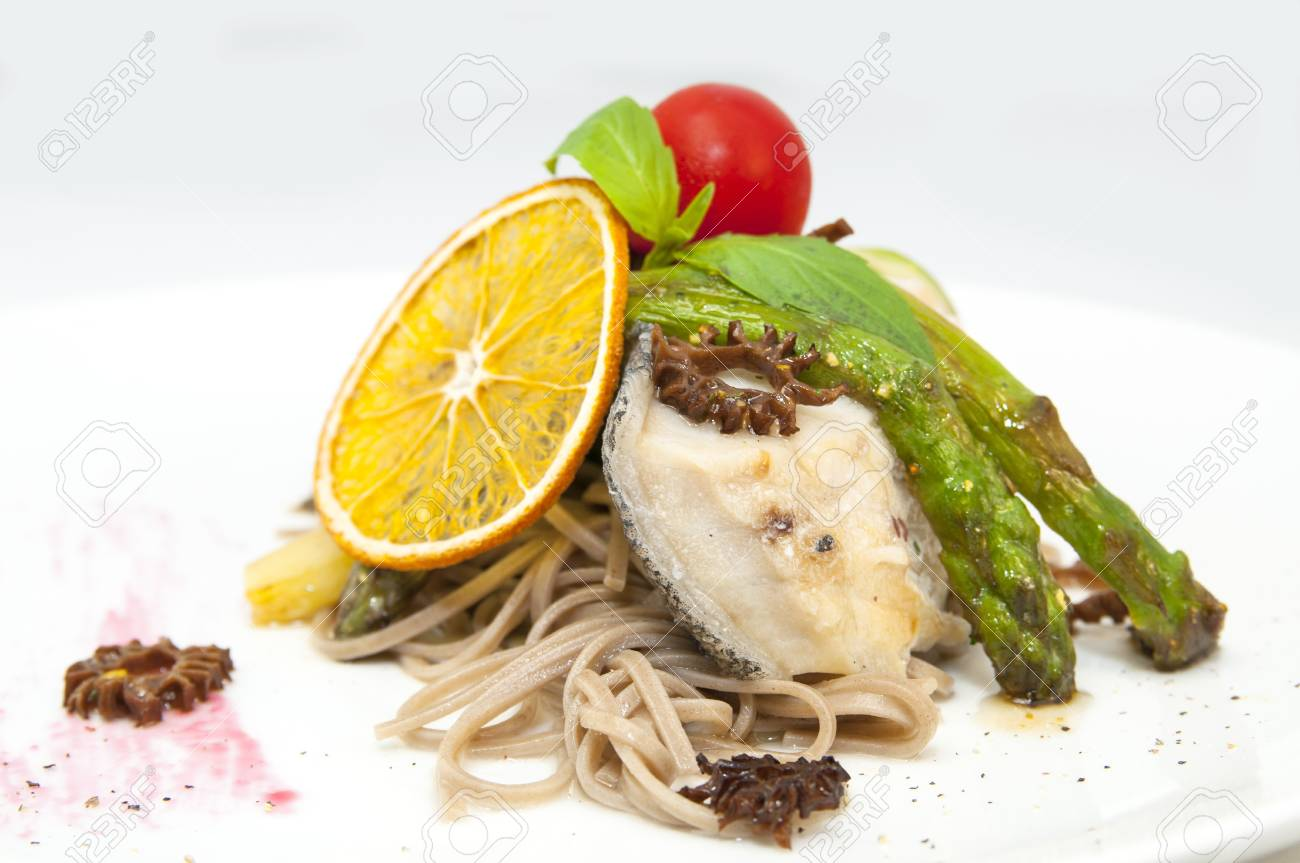 baked fish with spaghetti and mushrooms and vegetables Stock Photo - 16981045