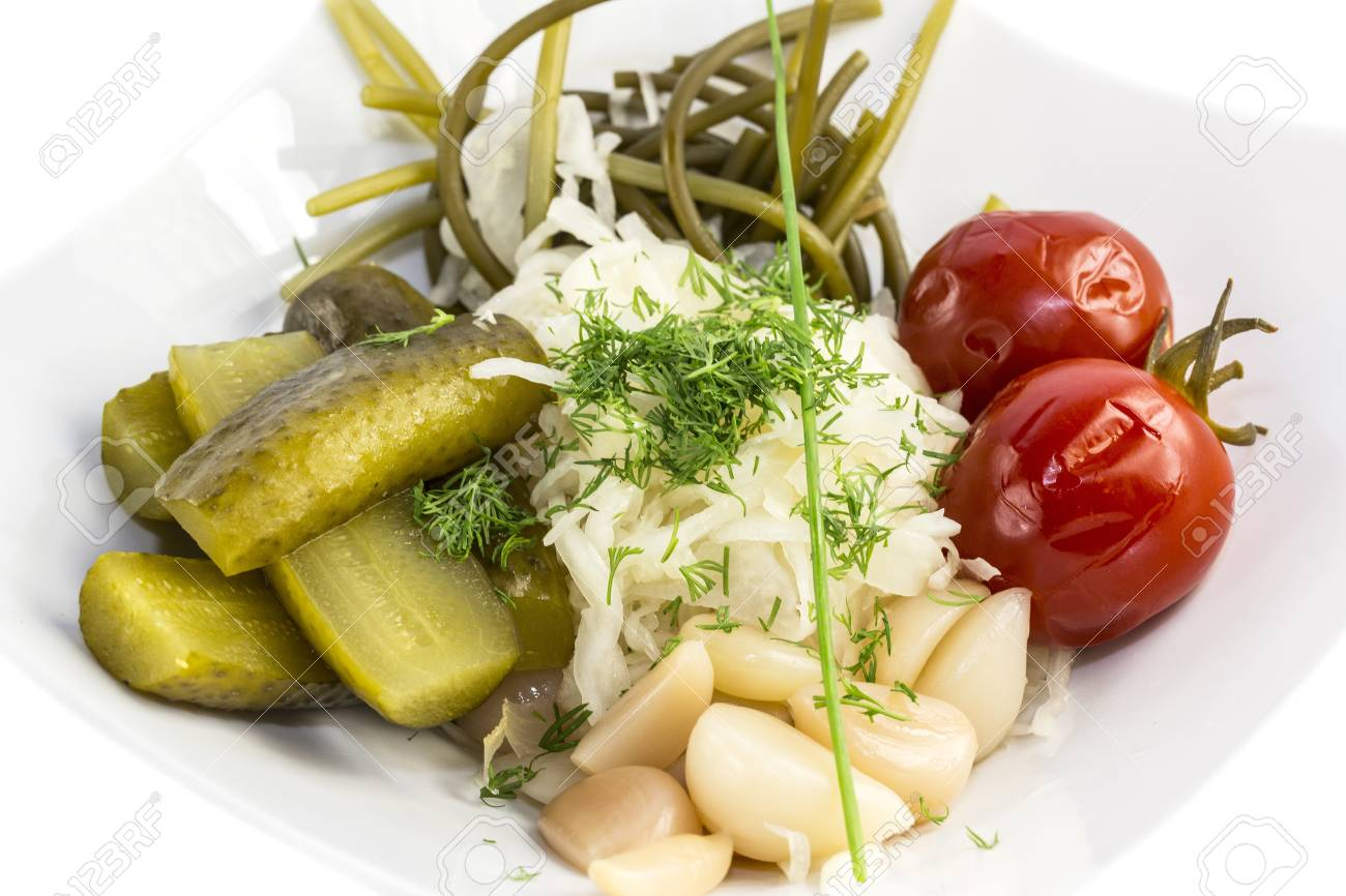 pickled vegetables, cucumber tomatoes asparagus and garlic cabbage Stock Photo - 17097206