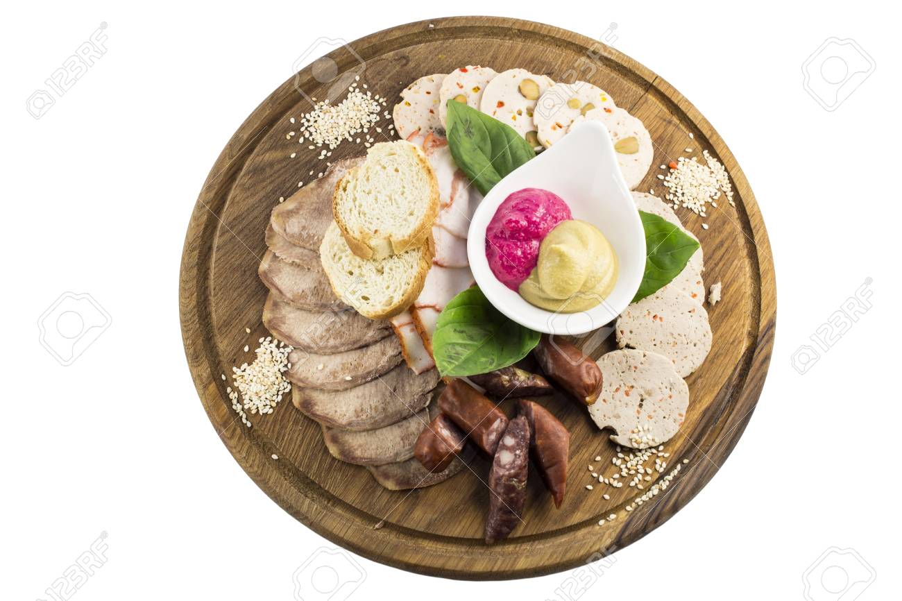 wooden plate with several kinds of sausages and bacon Stock Photo - 17096939