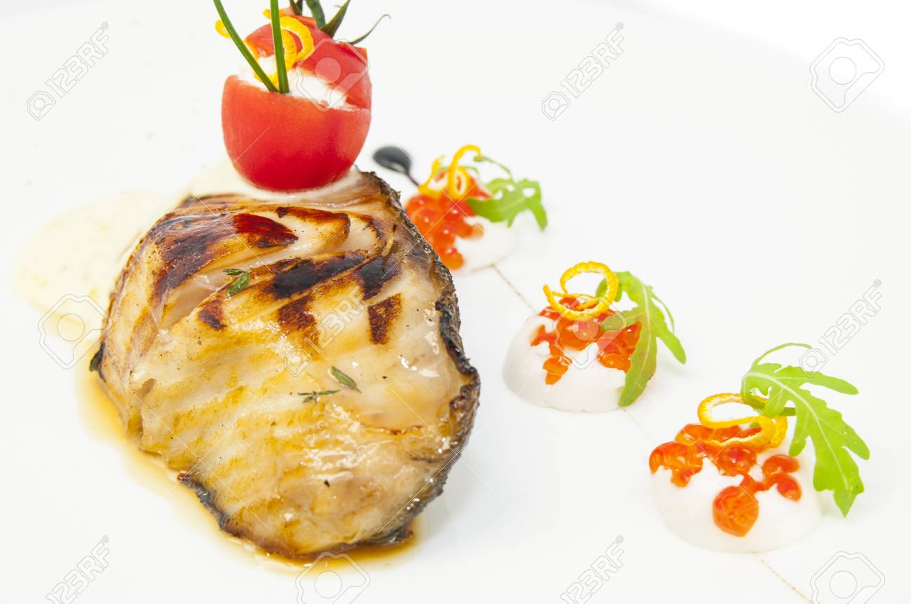 Roasted fillet of grilled fish in a white sauce Stock Photo - 17946077