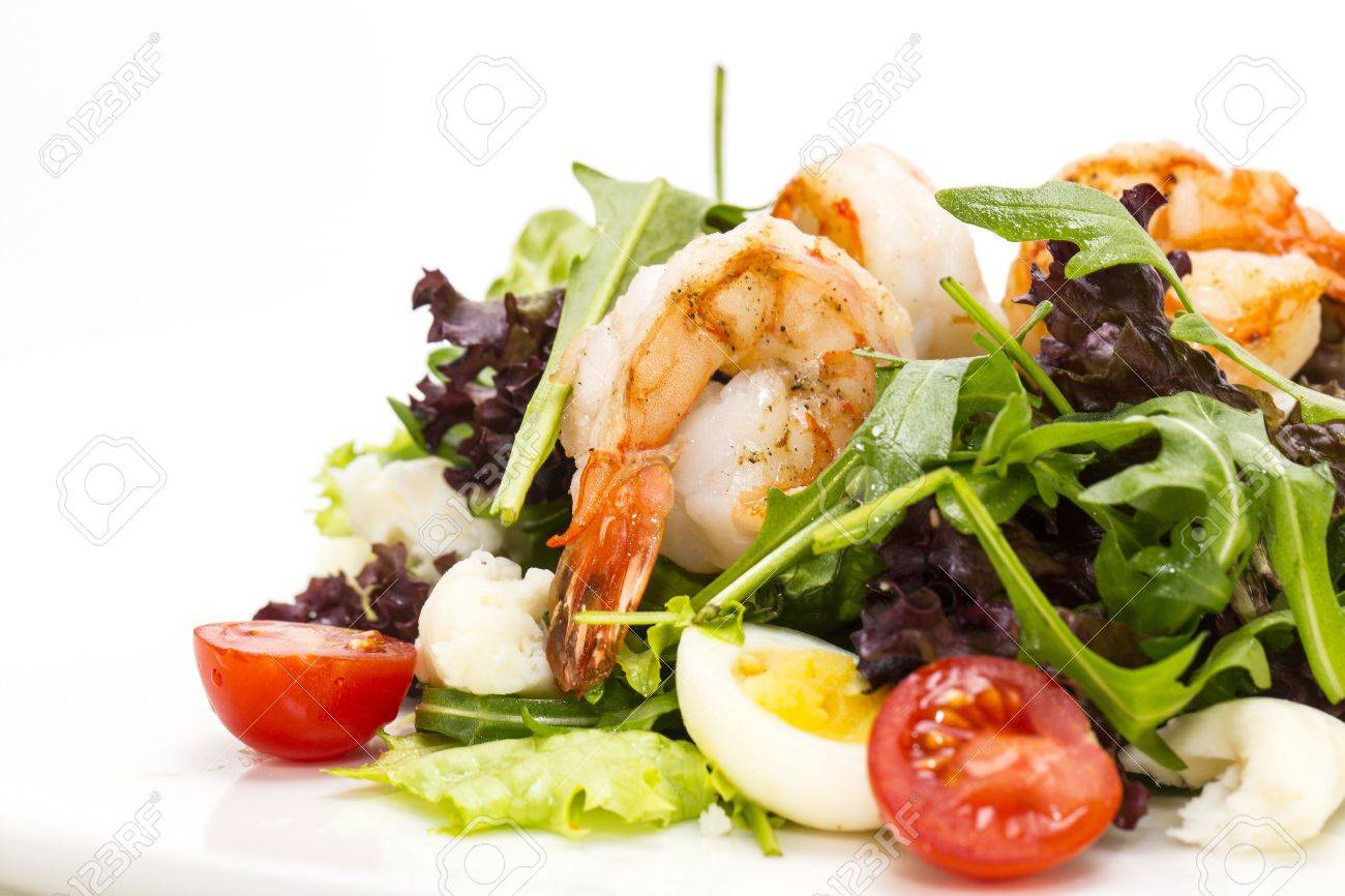 salad greens and shrimp on a white background in the restaurant - 18565860