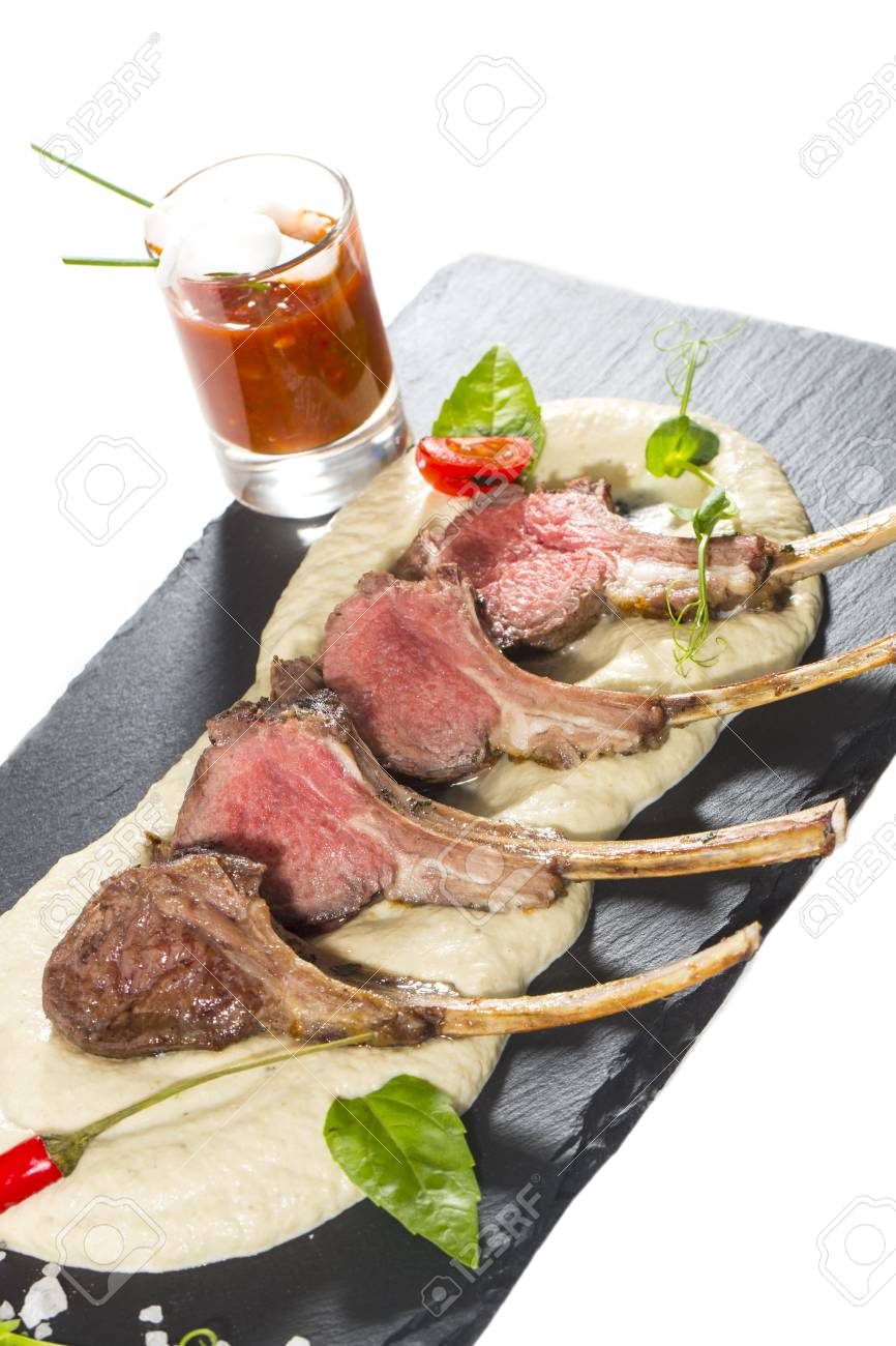 lamb ribs cooked on the grill served on a hot stone Stock Photo - 25113698