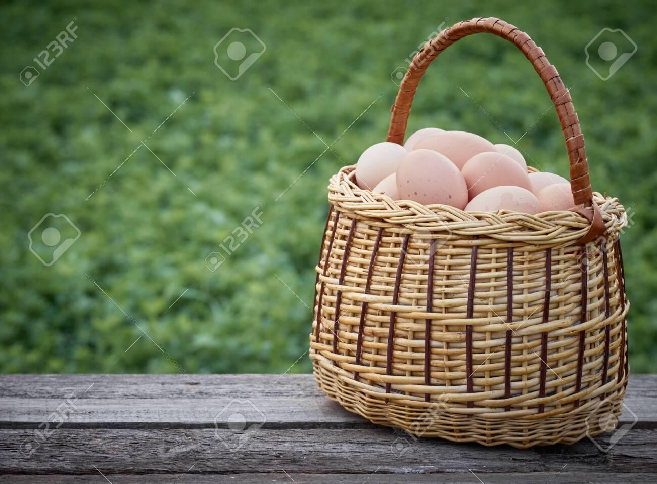 Chicken eggs in a basket. - 146446438