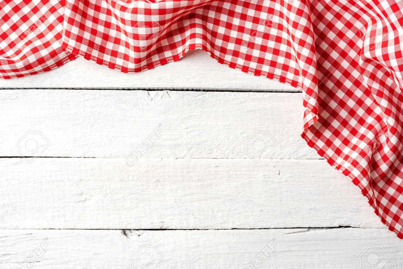 Red checkered tablecloth on white wooden table. Top view - 151590789