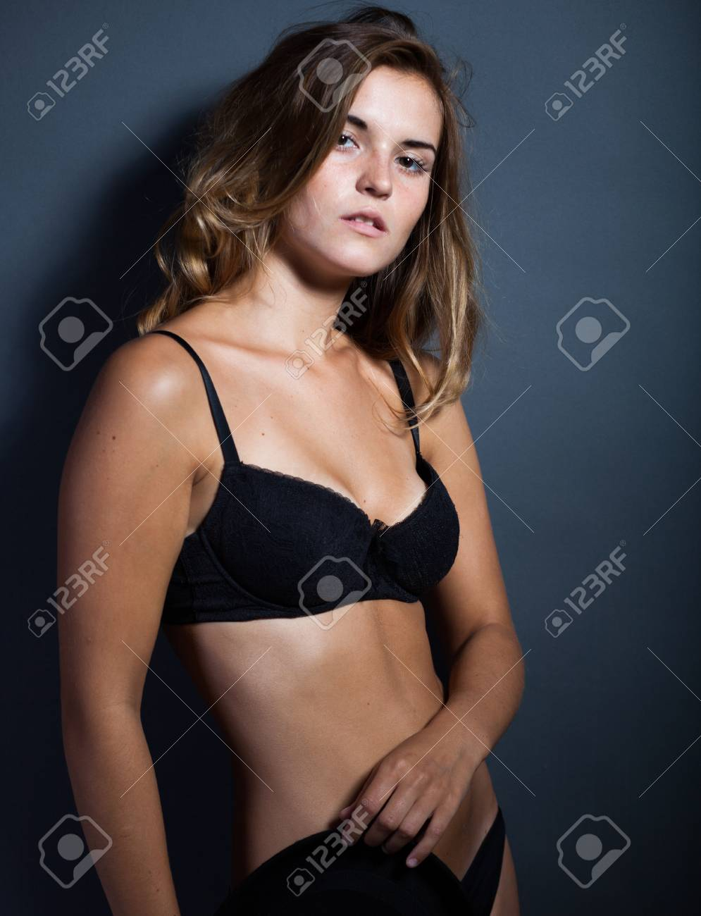 d14e61a0f90 Portrait of hot woman in lingerie on dark background Stock Photo - 22937794