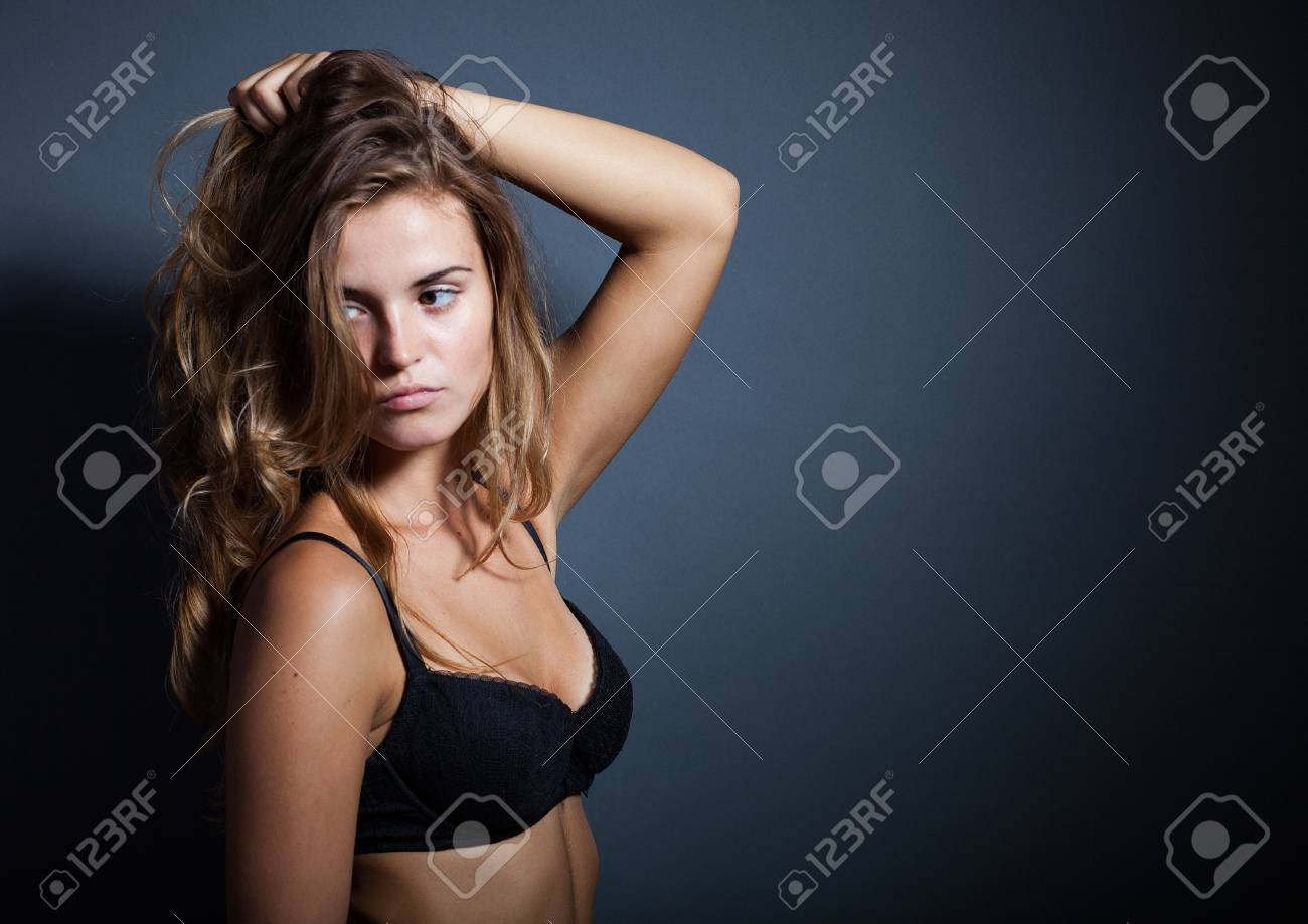 44cca3b8ebe Portrait of hot woman in lingerie on dark background Stock Photo - 22937793