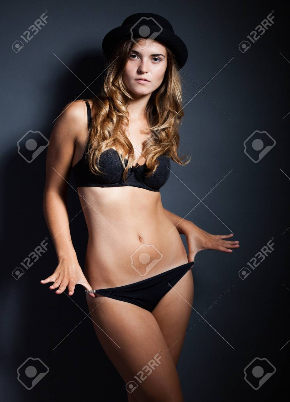 1814929dfac Sexy young woman in lingerie and hat on dark background Stock Photo -  22937866