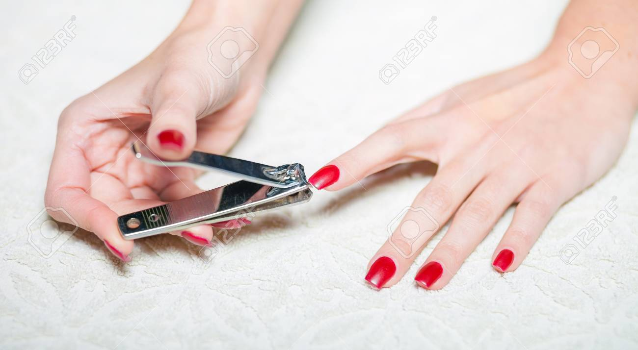 Woman Hand Manicure With Nail Clipper Stock Photo, Picture And ...