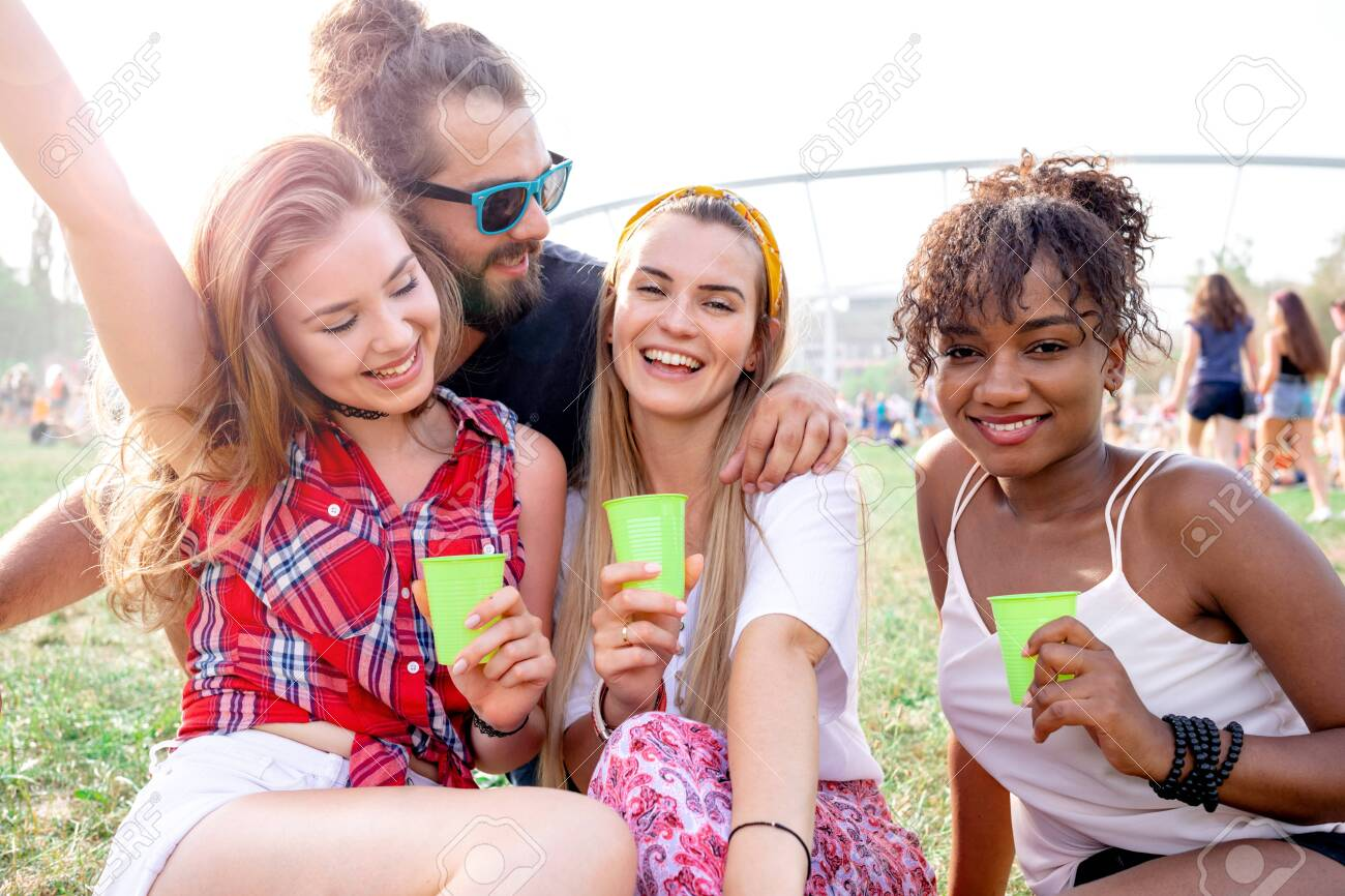 Group of friends having fun at summer music festival - 126320035