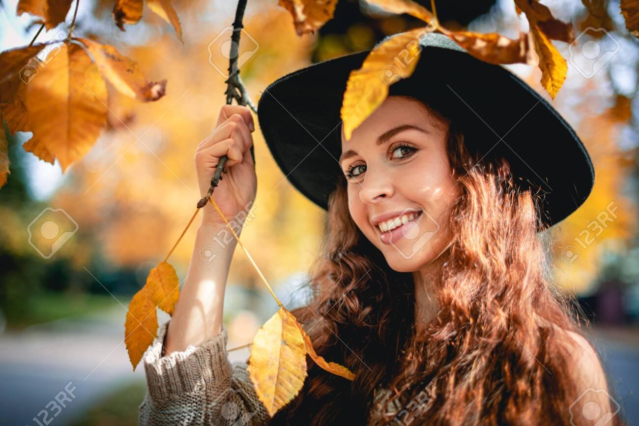 Young woman walking outdoors in autumn enjoying weather - 138889624