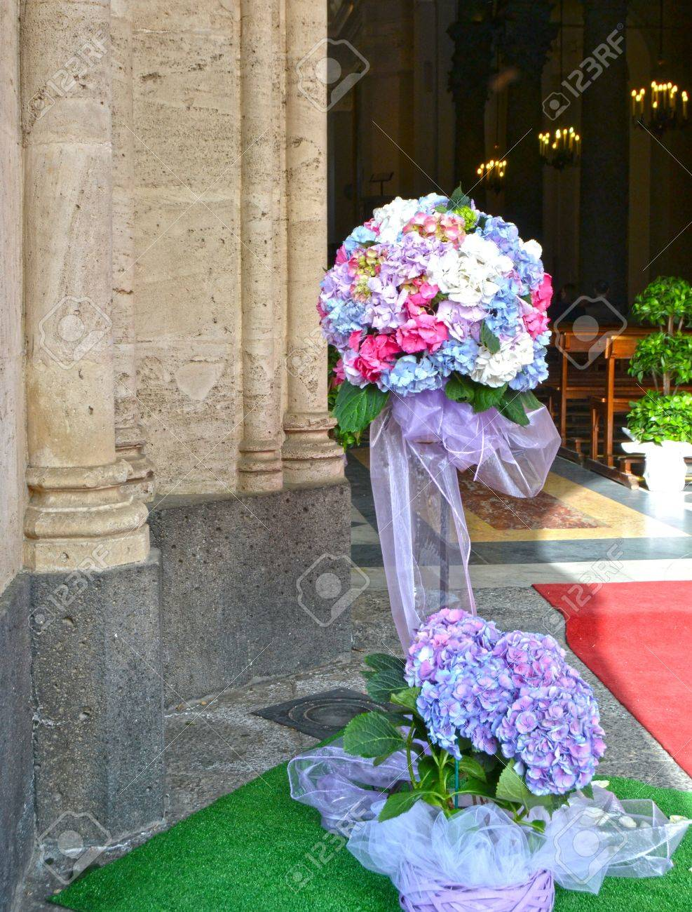 Floral Decorations At The Entrance Of The Church Stock Photo