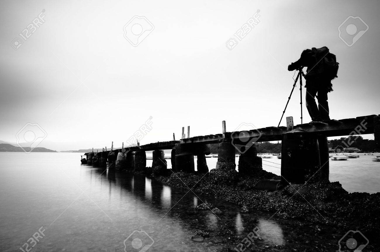 a man taking photo on the wooden pier, black and white Stock Photo - 6366702
