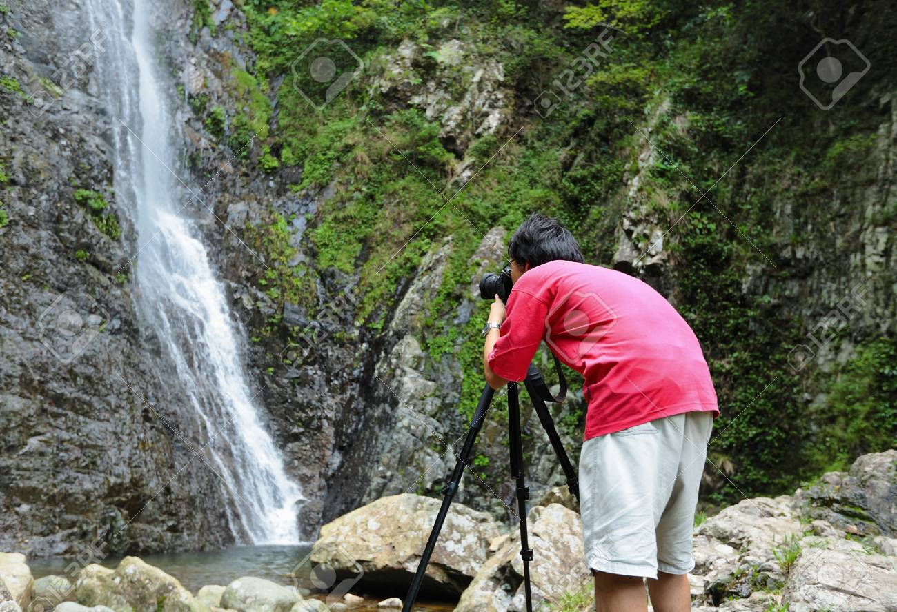 photographer taking picture of waterfall Stock Photo - 9996339