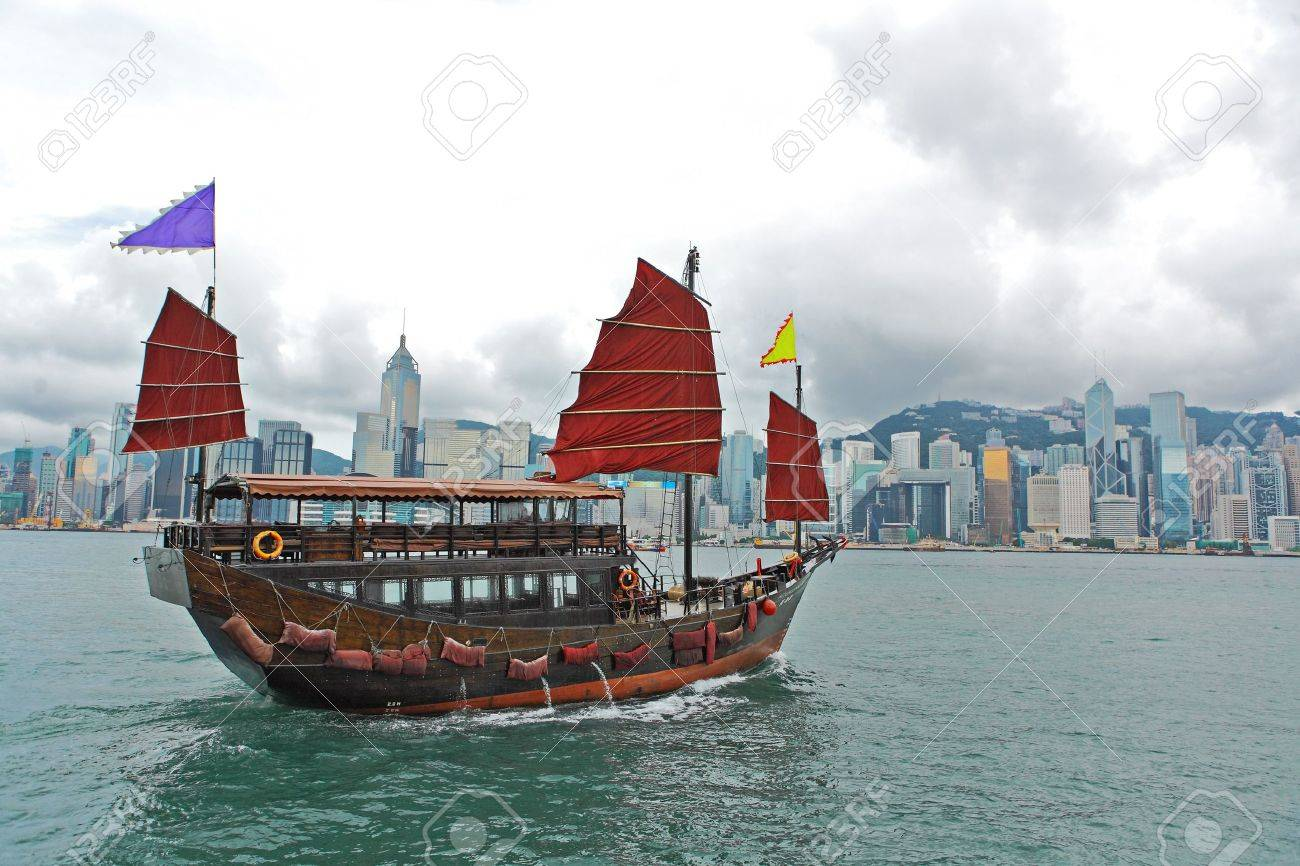 Hong Kong harbour with tourist junk Stock Photo - 10007892